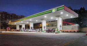 A night time view of vehicles filling up on the forecourt of a BP service station at the Qingxi site in Shanghai, China